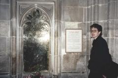 Tamara [& Geoffrey] at Jane Austen's grave in Winchester Cathedral, England